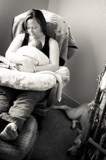 Mom rocking infant in glider rocker after nursing, photo Courtesy of Red Blossom Photography