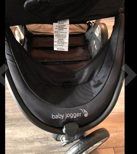 Baby Jogger City Mini 2 review under storage access from under leg rest.